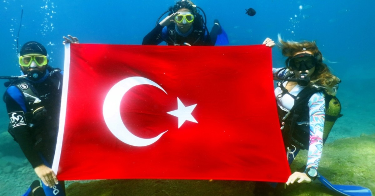 Divers in Fethiye dived into the depths of the Mediterranean Sea to unfurl the Turkish flag to mark August 30 Victory Day. (AA Photo)