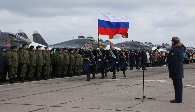 A handout picture shows a ceremony of meeting of the first group of Su-34 bombers and military personnel upon arrival at the airbase in Voronezh region, from the Syrian Hemeimeem airbase, in Russia, March 15, 2016. (EPA / Russian Defense Ministry)
