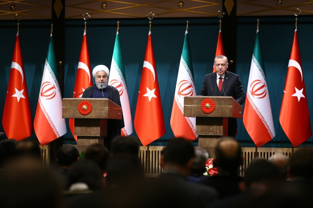 President Recep Tayyip Erdou011fan (R) and his Iranian counterpart Hassan Rouhani hold a joint news conference after their meeting in Ankara yesterday.