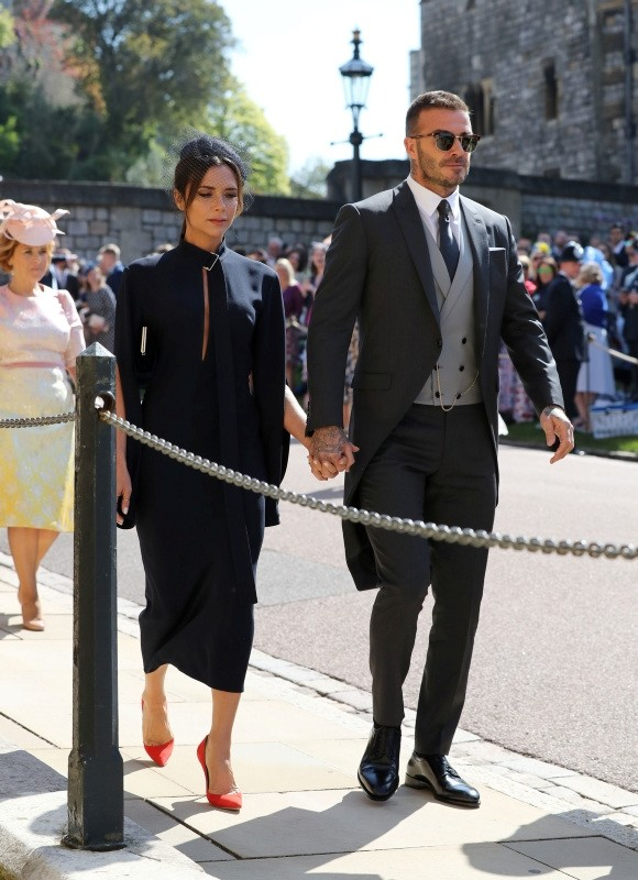 David and Victoria Beckham arrive for the wedding ceremony of Prince Harry and Meghan Markle at St. George's Chapel in Windsor Castle in Windsor, near London, England, Saturday, May 19, 2018.