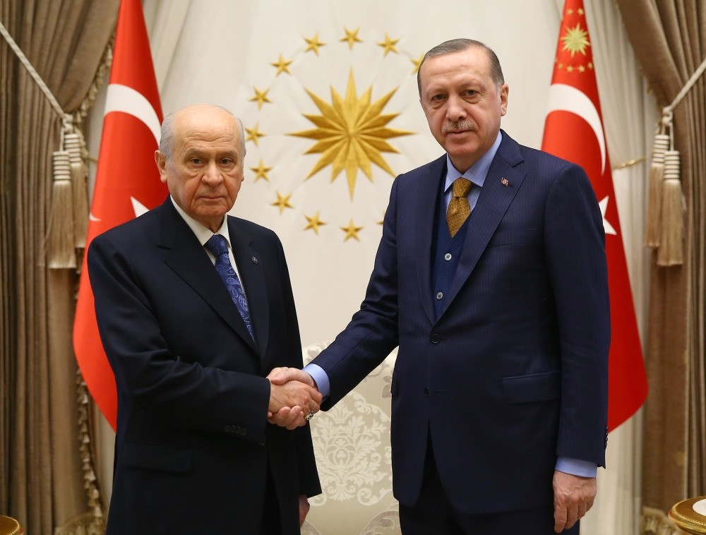 President Erdou011fan shakes hand with MHP Chairman Devlet Bahu00e7eli ahead of their 35-minute meeting at the Beu015ftepe Presidential Complex in Ankara yesterday.