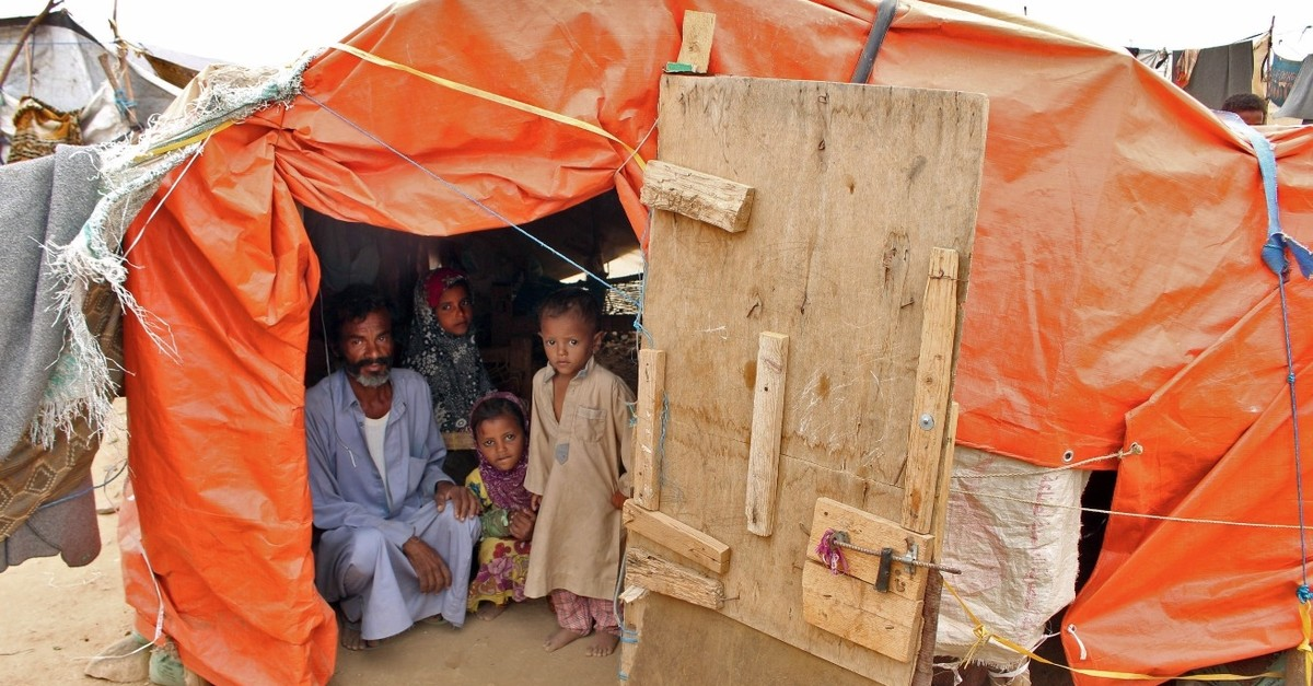 Displaced people pose in a makeshift camp in the northern district of Abs in Yemenu2019s northwestern Hajjah province, March 6, 2019.