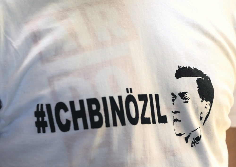 A T-shirt bearing the words ,I am u00d6zil, is worn by a protester during a demonstration against the German government's treatment of international football star Mesut u00d6zil, Germany.