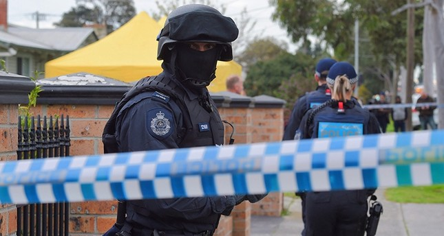 A picture made available on 07 August 2016 shows Australian Federal Police (AFP) officers conducting a terror raid at a house on Ballarat Rd in Braybrook, a suburb west of Melbourne (EPA Photo)
