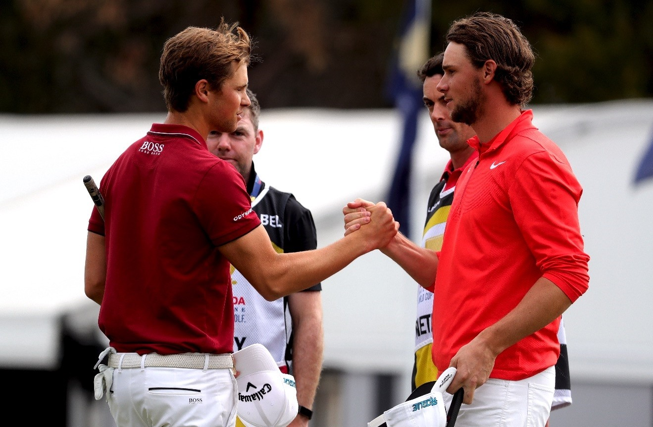 Thomas Detry (L) and Thomas Pieters of Belgium pose together after putting out on the 18th during the World Cup of Golf Tournament in Melbourne, Australia, yesterday.