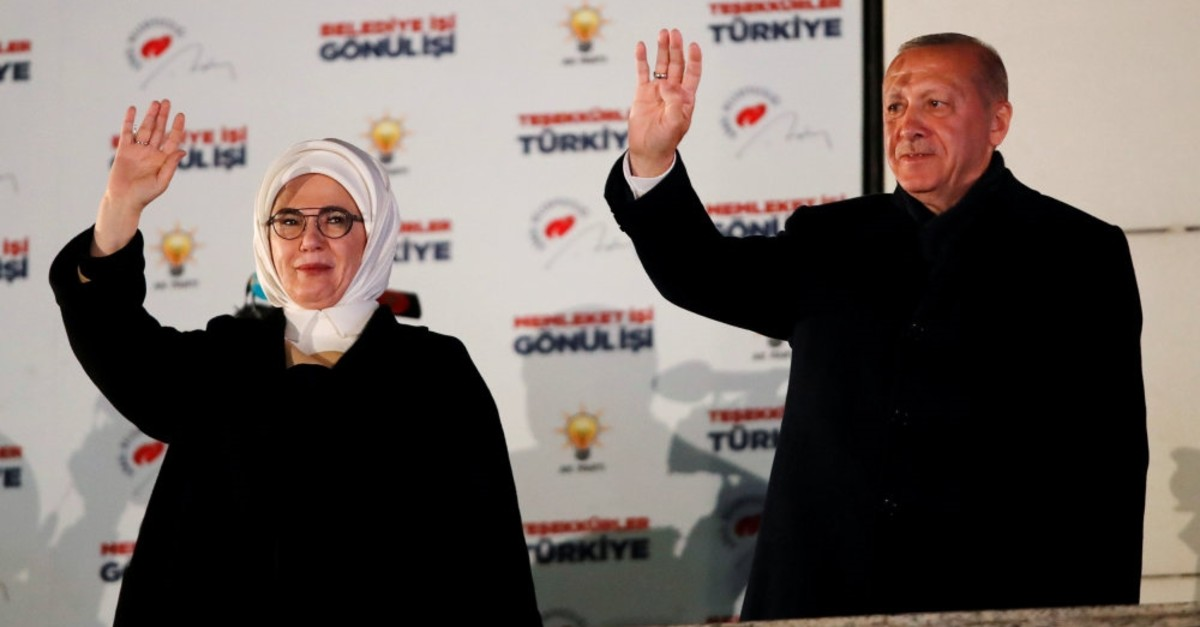 President Recep Tayyip Erdou011fan and first lady Emine Erdou011fan greet Justice and Development (AK Party) supporters during the president's traditional balcony address in Ankara, April 1, 2019.
