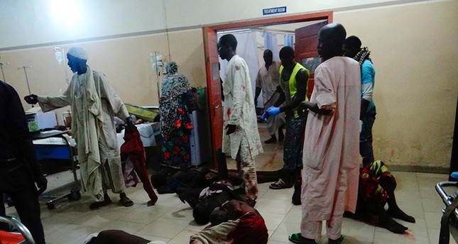 Injured victims of a female suicide bomber lie on the floor awaiting medical attention as beds were no longer available at a Maiduguri hospital in northeastern Nigeria on August 15, 2017. (AFP Photo)