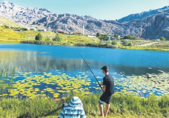 Two youngsters fish at Lake Dipsiz, located between Konya and Antalya provinces.
