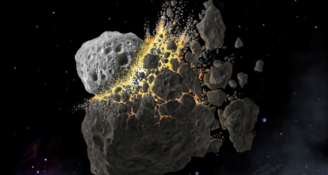 This illustration shows a giant asteroid collision between Mars and Jupiter that occurred 466 million years ago and produced the dust that led to an ice age on Earth (Reuters Photo)