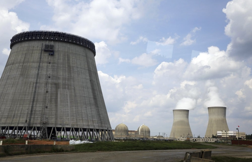 A new cooling tower for a nuclear reactor under construction near two operating reactors at Plant Vogtle in Waynesboro, Ga., operated by Westinghouse Electric Co., the U.S. nuclear unit of Japan's Toshiba Corp.