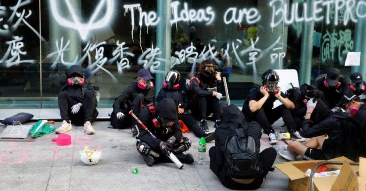 Protesters rest on the campus of Hong Kong Polytechnic University (PolyU) after clashes with police in Hong Kong, China November 18, 2019. (Reuters Photo)