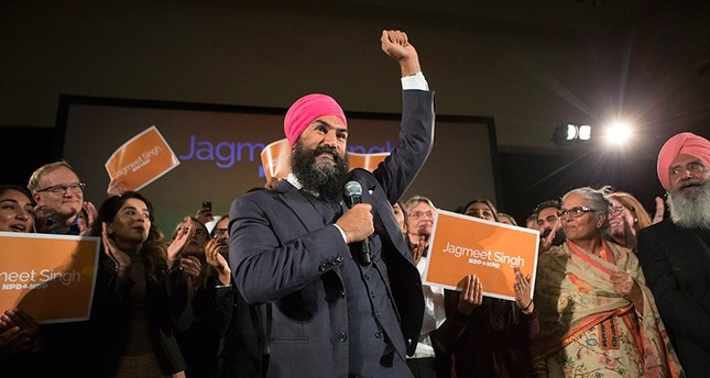 Jagmeet Singh celebrates with supporters after his first-ballot triumph in the contest for leader of the leftist New Democrat party in Toronto on Sunday, Oct. 1, 2017 AP Photo