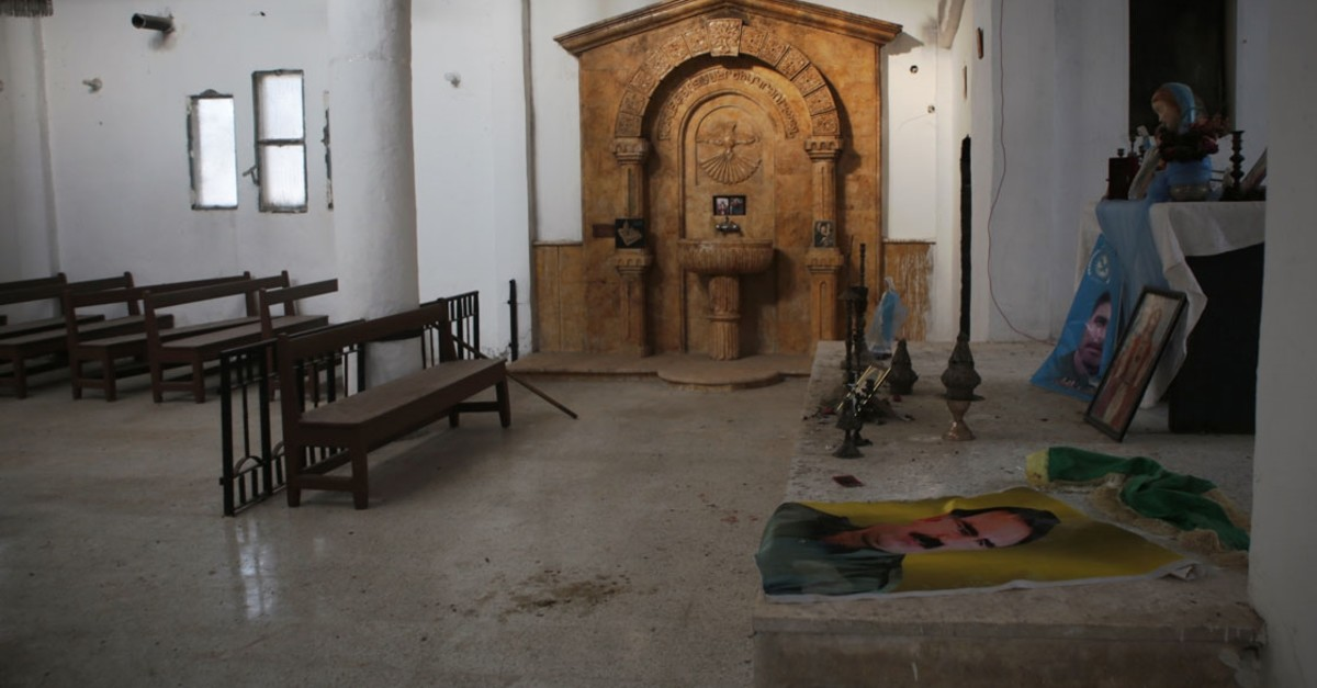 The pulpit used by the pastor decorated with posters of the PKK leader Abdullah u00d6calan (AA Photo)