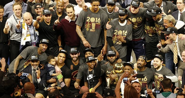 Cleveland Cavaliers pose for a team photo with the NBA Finals Championship Trophy after defeating the Golden State Warriors in NBA Finals game seven EPA