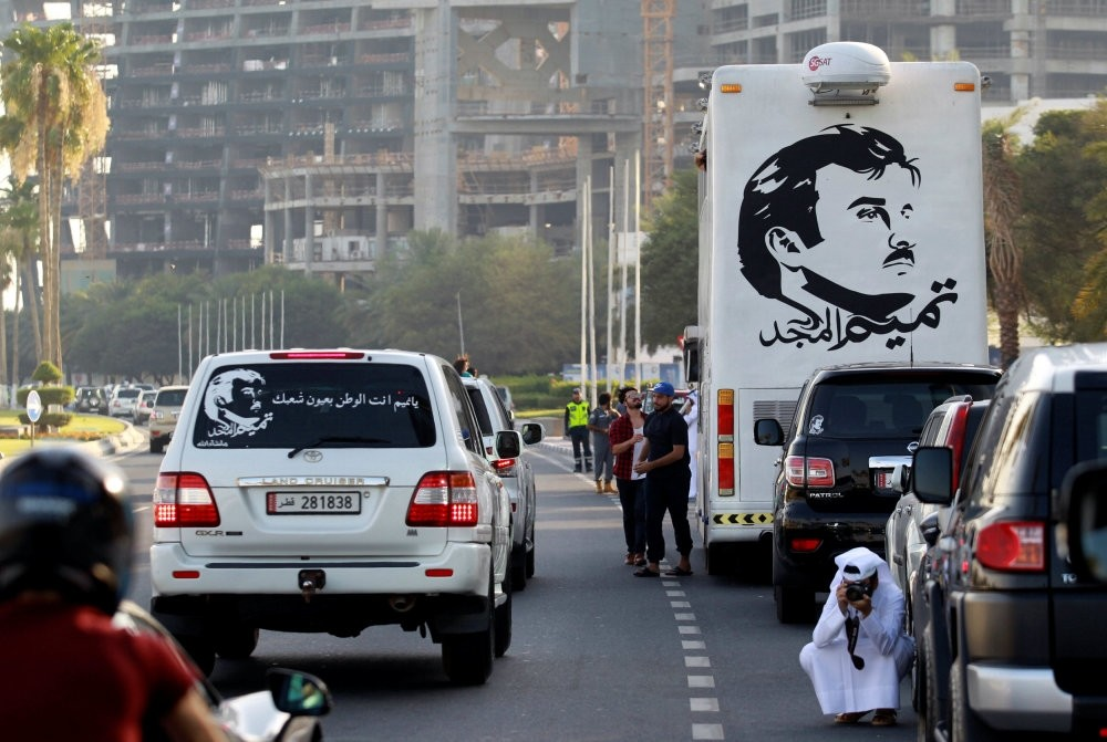 A painting depicting Qatari Emir Sheikh Tamim bin Hamad al-Thani on a bus during a demonstration against the imposed blockade by several Gulf states and in support of him in Doha, June 11.
