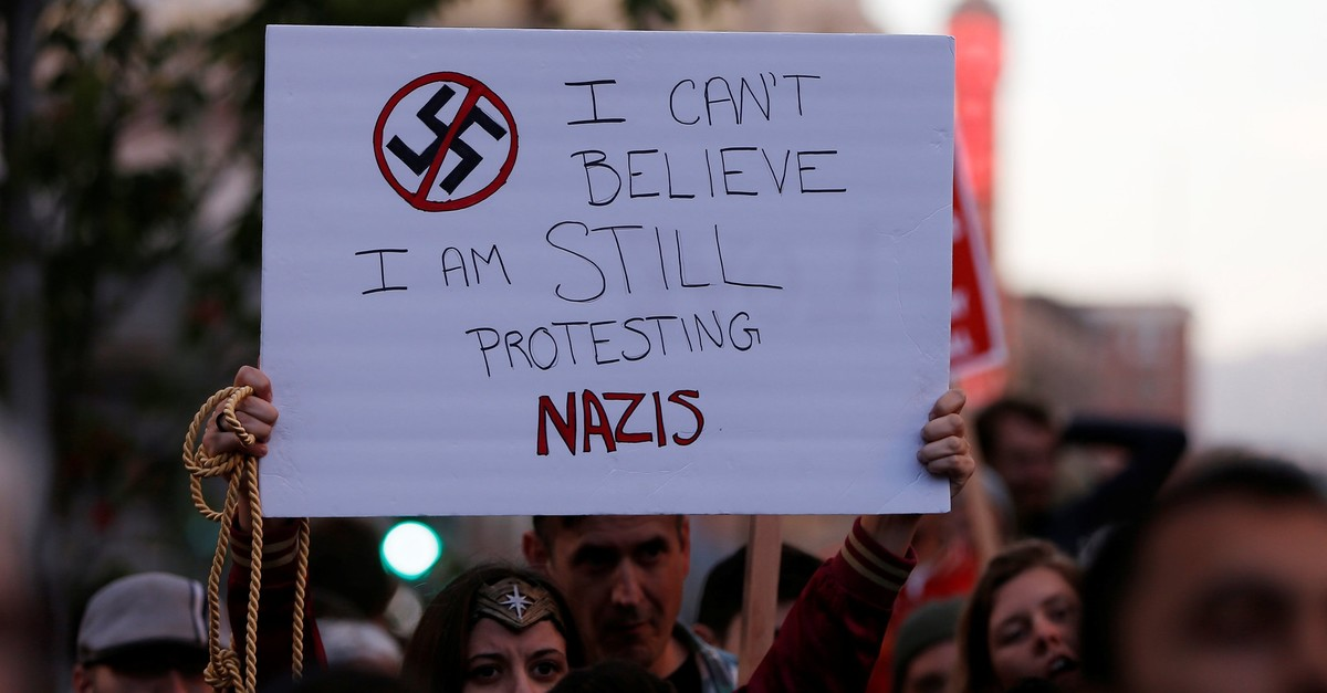 A demonstrator holds a sign during a rally, Oakland, California, Aug. 12, 2017. (REUTERS Photo)
