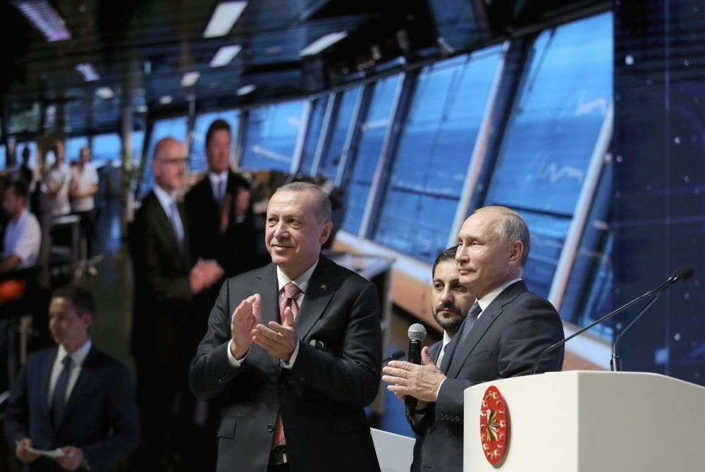 President Recep Tayyip Erdou011fan (L) and Russian President Vladimir Putin (R) applaud as they attend an event in Istanbul marking the completion of one of the phases of the TurkStream natural gas pipeline, Nov. 19.