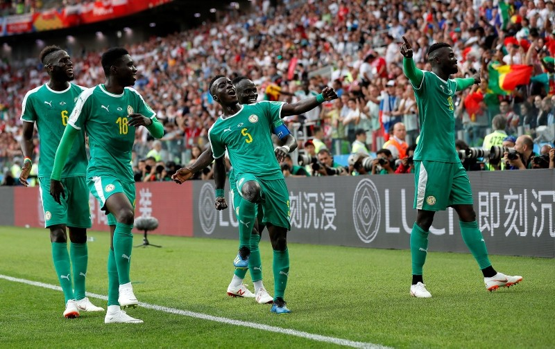 M'Baye Niang of Senegal (R) celebrates with teammates during the FIFA World Cup 2018 group H preliminary round soccer match between Poland and Senegal in Moscow, Russia, June 19, 2018. (EPA Photo)