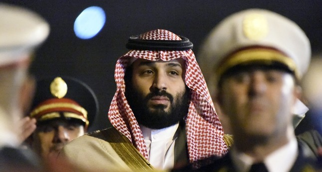 Saudi Crown Prince Mohammed bin Salman is seen behind a military band upon his arrival at Algiers International Airport, Dec. 2.
