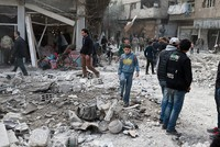 Suspected Russian jets killed at least 20 civilians and wounded dozens early Thursday when they dropped bombs on two residential buildings in a besieged opposition enclave east of the Syrian...