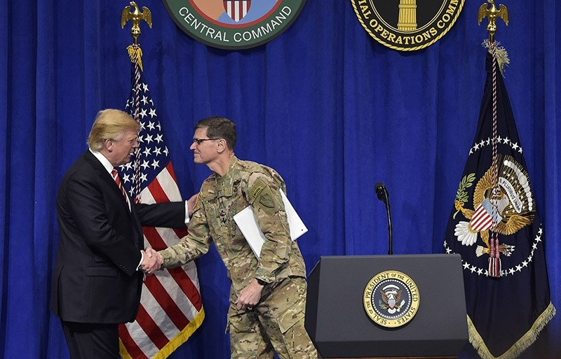 US President Donald Trump (L) shakes hands with CENTCOM Commander Joseph Votel (R) on Feb. 6, 2017 in Tampa, Florida. (AFP File Photo)