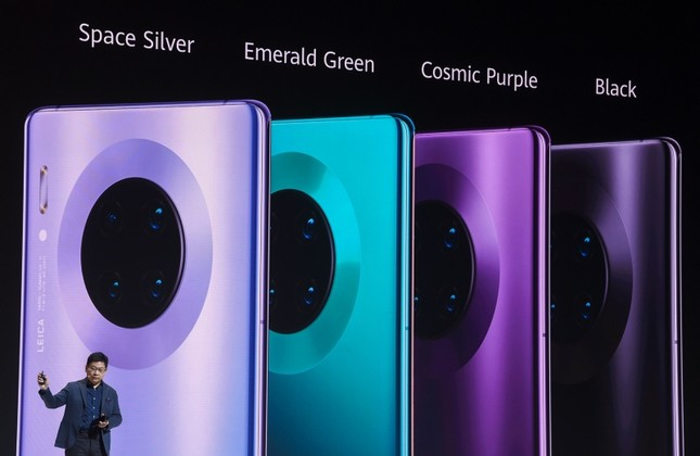 Richard Yu, CEO of the Huawei consumer business group, presents the new 'Mate 30 Pro' smartphone during an event in Munich, Germany, Thursday, Sept. 19, 2019. (AFP Photo)