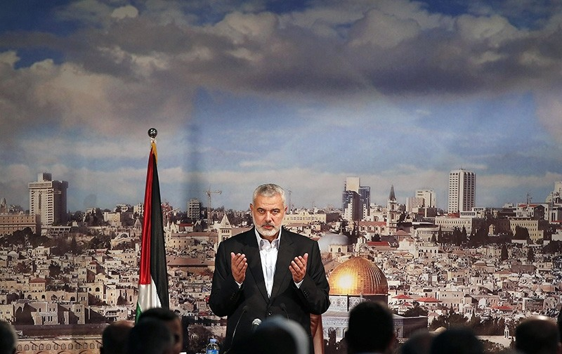 Ismail Haniyeh, prime minister of the Hamas Gaza government, prays before delivering a speech in Gaza City October 19, 2013 (Reuters Photo)