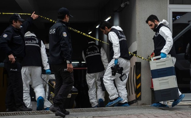 Forensic police officers stand at an underground car park cordoned off by Turkish police after they found an abandoned car belonging to the Saudi Consulate on Oct. 23.