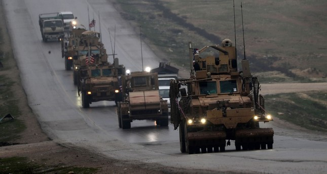 n this file photo taken on December 30, 2018 a convoy of US military vehicles rides in Syria's northern city of Manbij (AFP Photo)