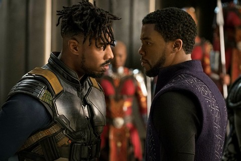 This image released by Disney shows Michael B. Jordan, left, and Chadwick Boseman in a scene from Marvel Studios'