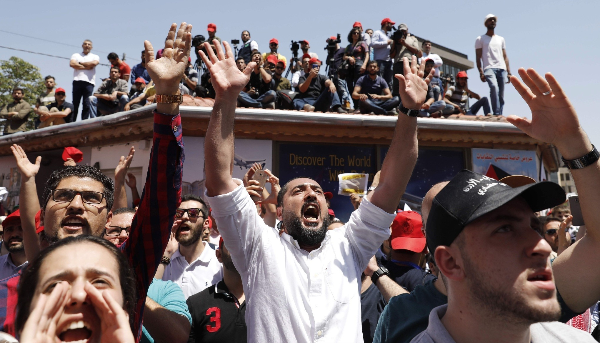 Demonstrators chant slogans in front of the Labor Union offices in Amman, June 6.