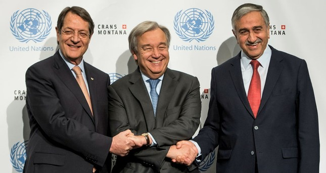 Greek Cypriot leader, Anastasiades, left, UN chief Guterres, center, and Turkish Cypriot leader, Akıncı, right, pose for a group picture in Crans-Montana, Switzerland. (AP Photo)