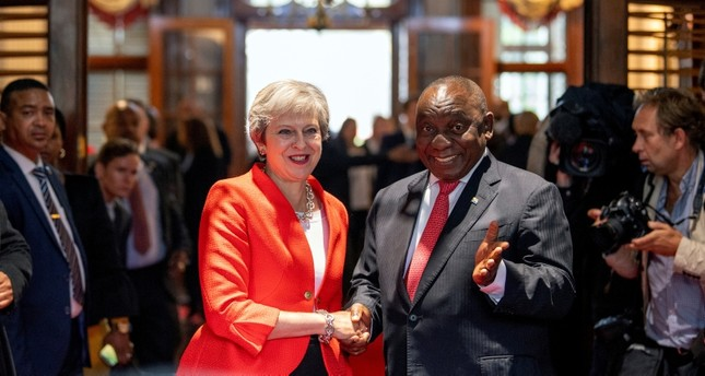 British Prime Minister Theresa May (L) meets with South African President Cyril Ramaphosa in Cape Town, South Africa, Tuesday, Aug. 28, 2018. (AP Photo)