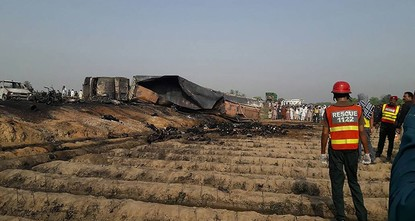 pAt least 148 people were killed and scores injured in a fire that erupted after an oil tanker overturned in central Pakistan early Sunday and crowds rushed to collect fuel, an official...
