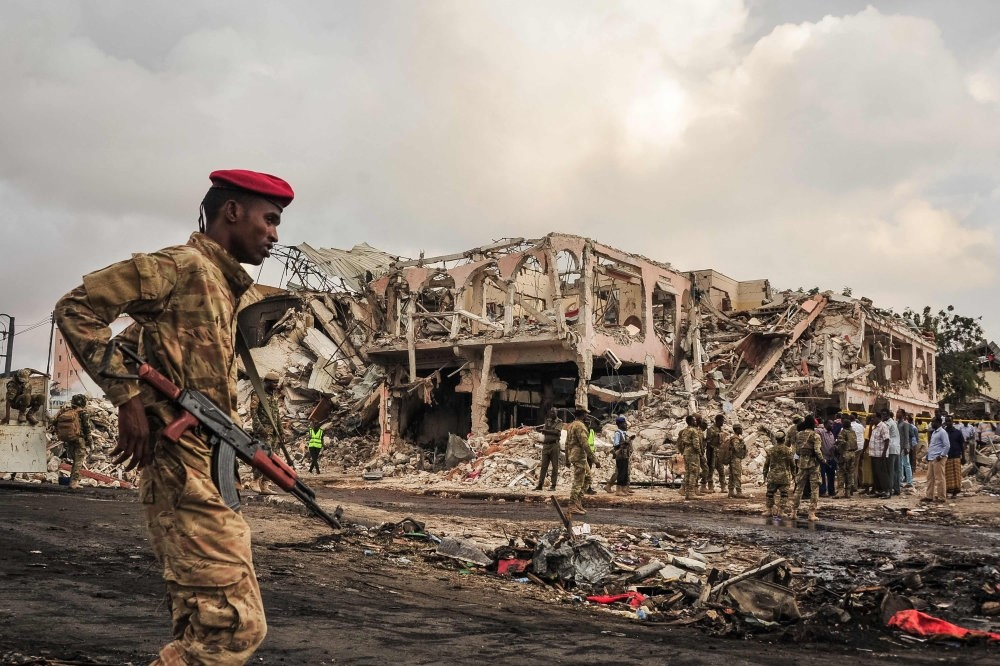 Somali soldiers patrol on the scene of the explosion of a truck bomb in the centre of Mogadishu, Oct. 15.