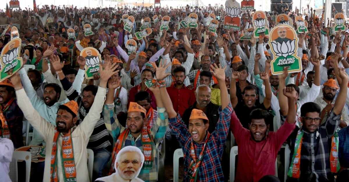 In this April 9, 2019, photo, Bharatiya Janata Party (BJP) supporters cheer at an election campaign rally in Hyderabad, India. (AP Photo)