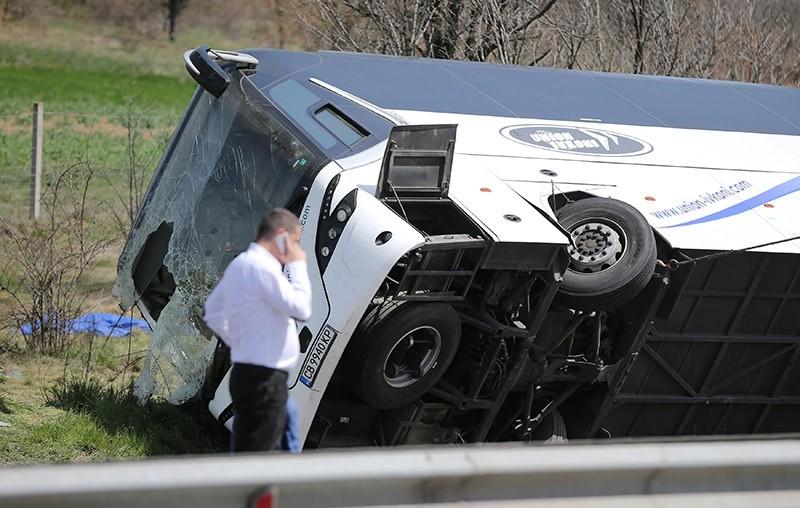 A man walks beside a crashed bus on a highway near capital Sofia, Bulgaria, April 13, 2018. (Reuters Photo)