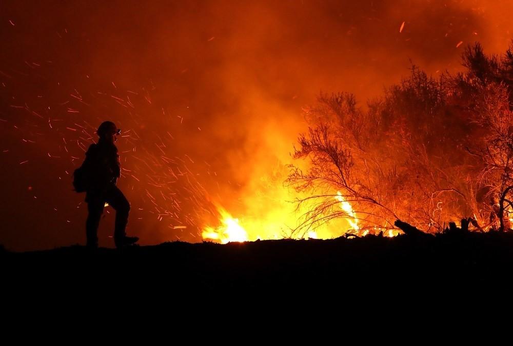 A California firefighter monitors the Medocino Complex fire.