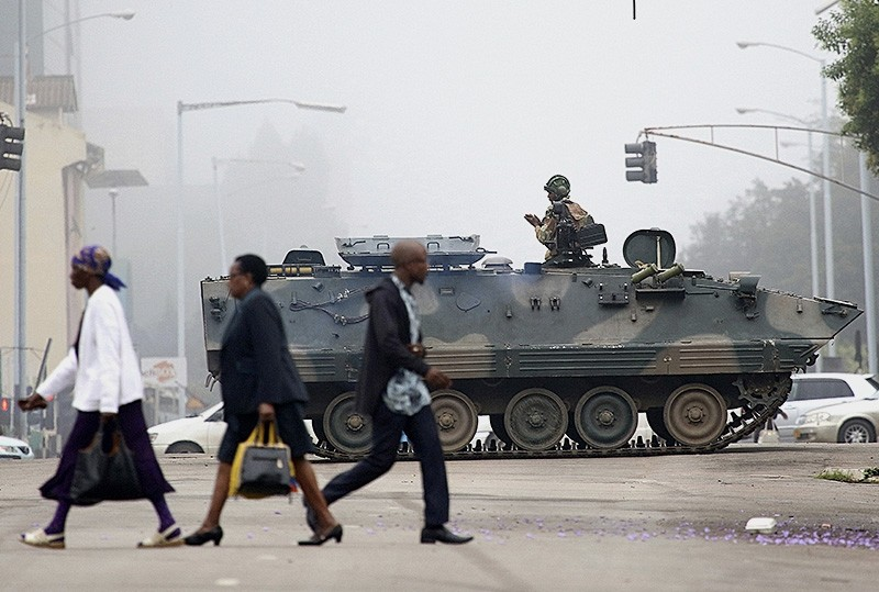 An armed soldier patrols a street in Harare, Zimbabwe, Wednesday, Nov. 15, 2017. (AP Photo)