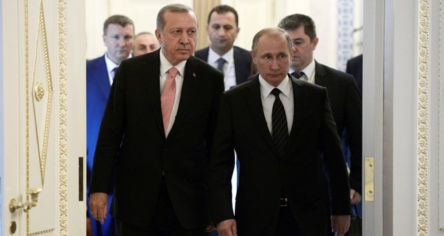 Turkish President Tayyip Erdoğan (L) and Russian President Vladimir Putin attend a press conference following their meeting in St. Petersburg yesterday.