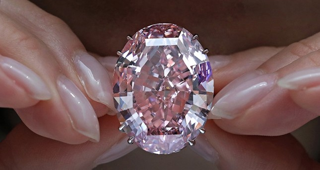 In this Wednesday, March 29, 2017, file photo, the Pink Star diamond, the most valuable cut diamond ever offered at auction, is displayed by a model at a Sotheby's auction room in Hong Kong. (AP Photo)