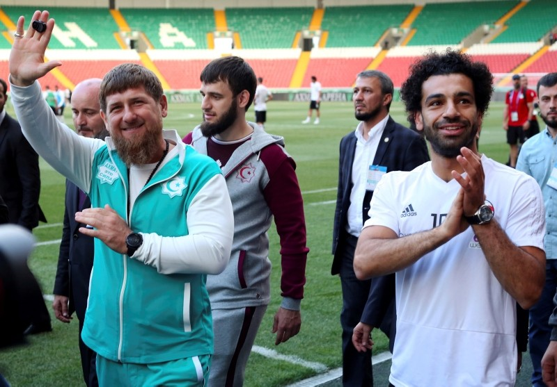 Egypt forward Mohamed Salah, right, and Chechnya's regional leader, Ramzan Kadyrov, greet soccer fans as they arrive to attend a team training session in Grozny, Russia. (AP Photo)