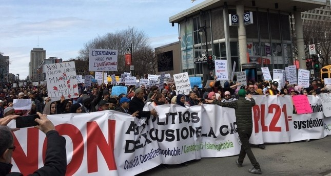 Demonstrators march to protest the proposal in Quebec, Canada. (IHA File Photo)