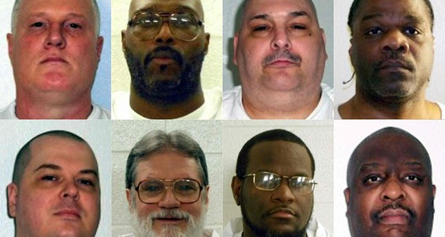 This combination of pictures show death row inmates (L-R, top) Don William Davis, Stacey Eugene Johnson, Jack Harold Jones and Ledell Lee; (L-R, bottom) Jason F. McGehee, Bruce Earl Ward, Kenneth D. Williams and Marcel W. Williams. (AFP Photo)