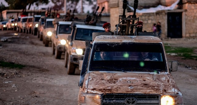 An FSA military convoy heads to Manbij as a part of the Turkish military's dispatch to the region for an operation east of the Euphrates, Dec.25.