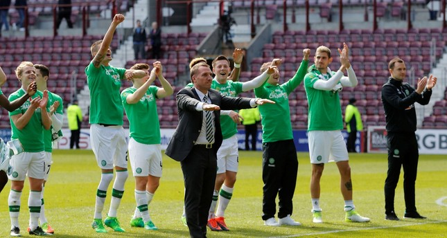 Celtic manager Brendan Rodgers and their players celebrate winning the Scottish Premiership. (Reuters Photo)