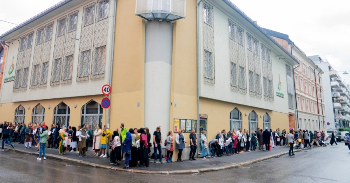 People gather to show support, outside the mosque Islamic Cultural Centre in Oslo, Sunday, Aug. 11, 2019. (AP Photo)