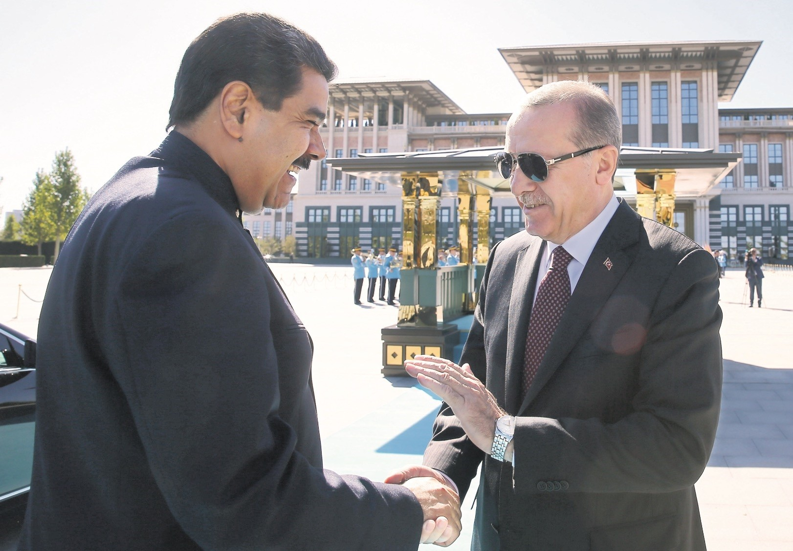 Nicolas Maduro, shaking hands with President Erdou011fan ahead of the presidential oath-taking ceromony, July 9.