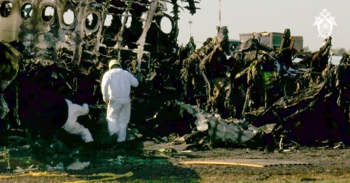 This photo taken from a video distributed by Russian Investigative Committee on Monday, May 6, 2019, shows employees working at the wreckage of the Sukhoi SSJ100 aircraft at Moscow's Sheremetyevo airport. (AP Photo)