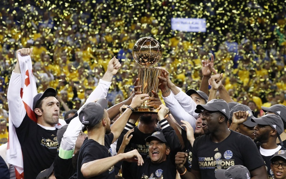 Golden State Warriors celebrate with the Larry Ou2019Brien NBA Championship Trophy after winning the NBA Finals against the Cleveland Cavaliers in Game 5 of the NBA Finals at Oracle Arena in Oakland.